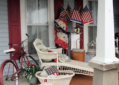 Patriotic porch complete with old red bike red white and for Country porch catalog