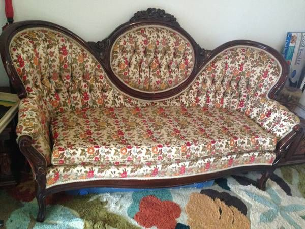 Mirrorback Victorian Couch With Giant Wings And 70s Style