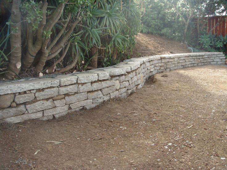 Urbanite wall - The material was free (broken concrete) - Dry set means no mortar expense and best of all it stays out of the landfill.