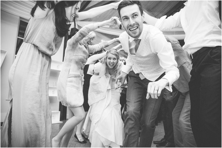 The bride and couple enjoying their wedding ceilidh at Brooksby Hall, Leicestershire