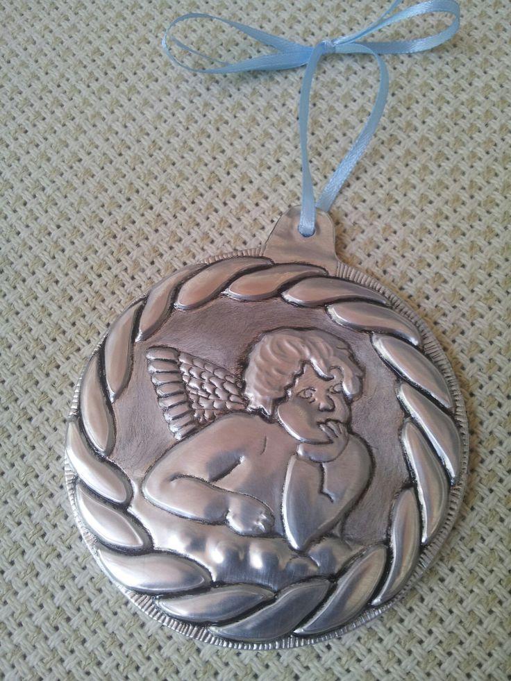 Medallón de angel para colocar en la cuna del bebé