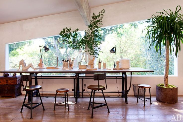 A drafting table and stools are also among the furnishings in the sculpture studio.