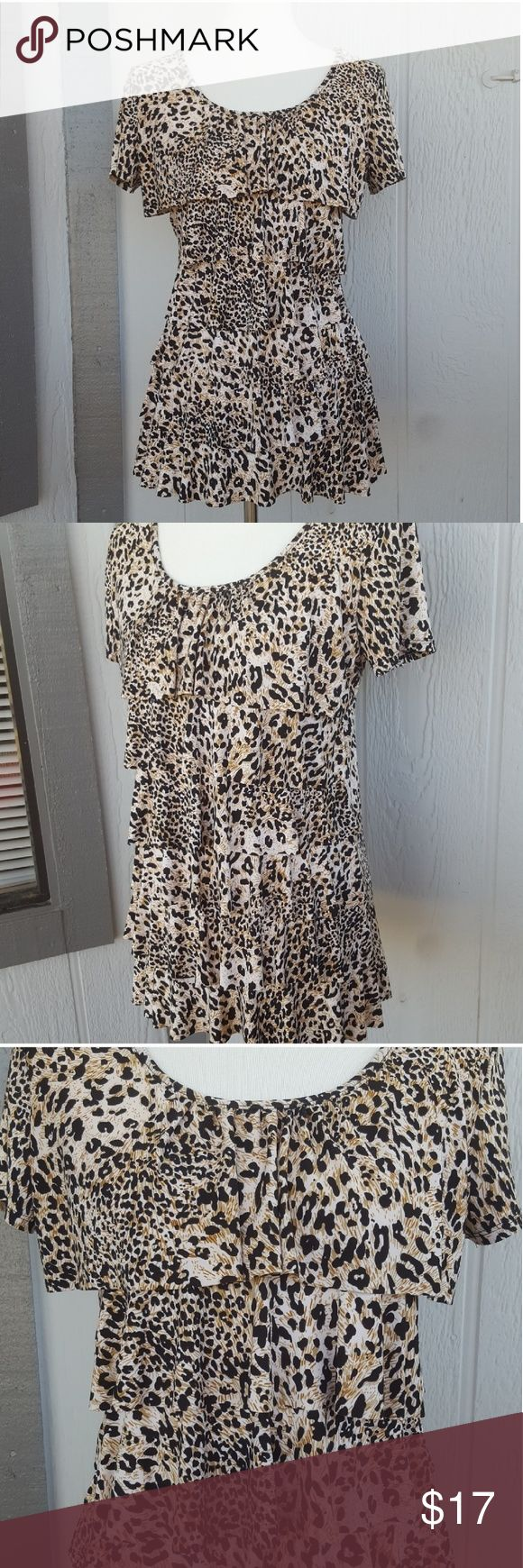 """Animal Print Cheetah Leopard Print Ruffle Blouse Short sleeve blouse in great shape. Has layers of ruffles. Stretchy and comfortable fabric. Perfect to wear with jeans or a skirt.  Polyester, spandex, elastane. Approximate measurements armpit to armpit to armpit to armpit to armpit 19"""". Length 28"""". Animal Print Cheetah Leopard Print Ruffle Blouse Andrea Missy Tops Blouses"""