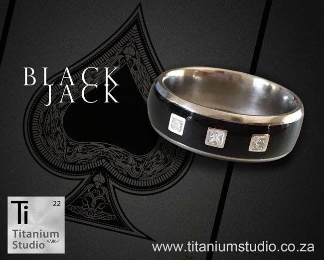 Black wedding ring set with 3 princess cut diamonds.