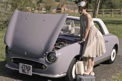I drive a Nissan Figaro…it's Lapis Grey. This photo was taken when I lent it for a fashion shoot…not me in the photo though!