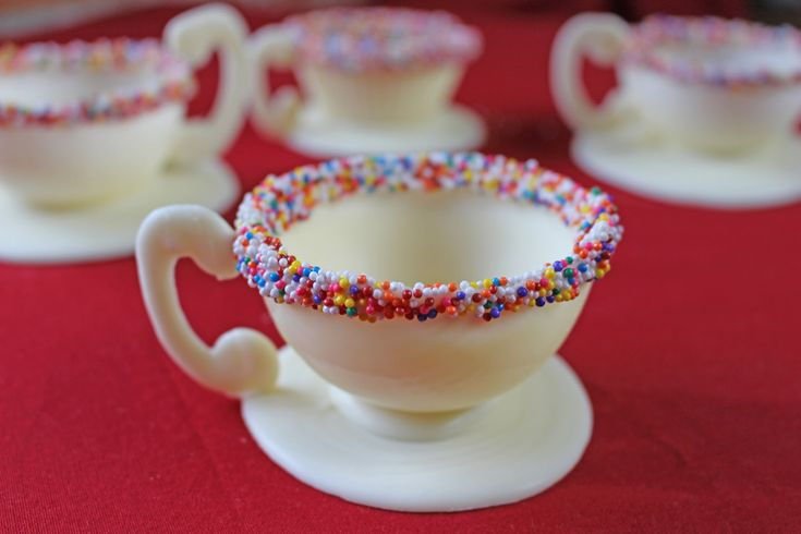 How to Make Edible Chocolate Dessert Cups; could also use the same idea to make a filled ball (two cups sealed together after adding goodies inside).