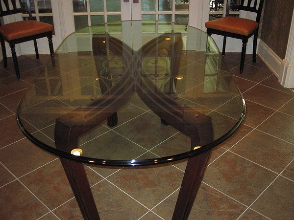 Ornate dining room table with Oggi glass Forza Metal | Residential