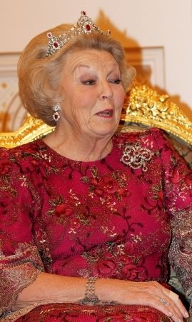 Beatrix of the Netherlands wearing portions of the Mellerio Ruby Parure.