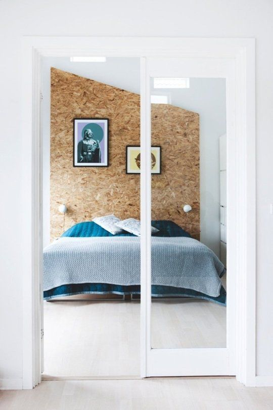 Love this OSB headboard/accent wall. Manages to look pretty luxe even with the budget material.