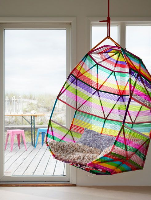a hanging chair, worthy of a pink, sparkly unicorn. or a 5 year-old girl.