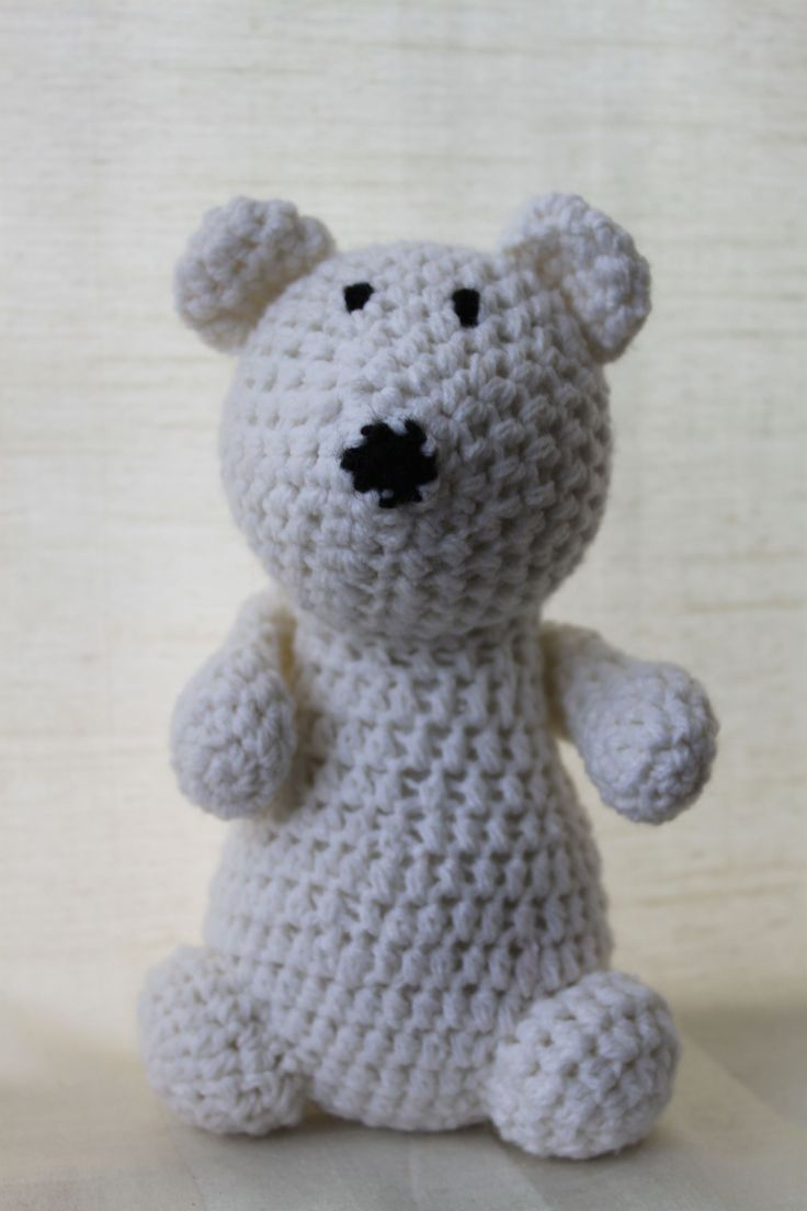Polly the polar bear. Amigurumi plush animal. The animal is approximately 20 cm tall.