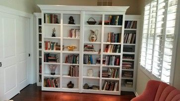 White Murphy Bed with pivoting Library bookcases
