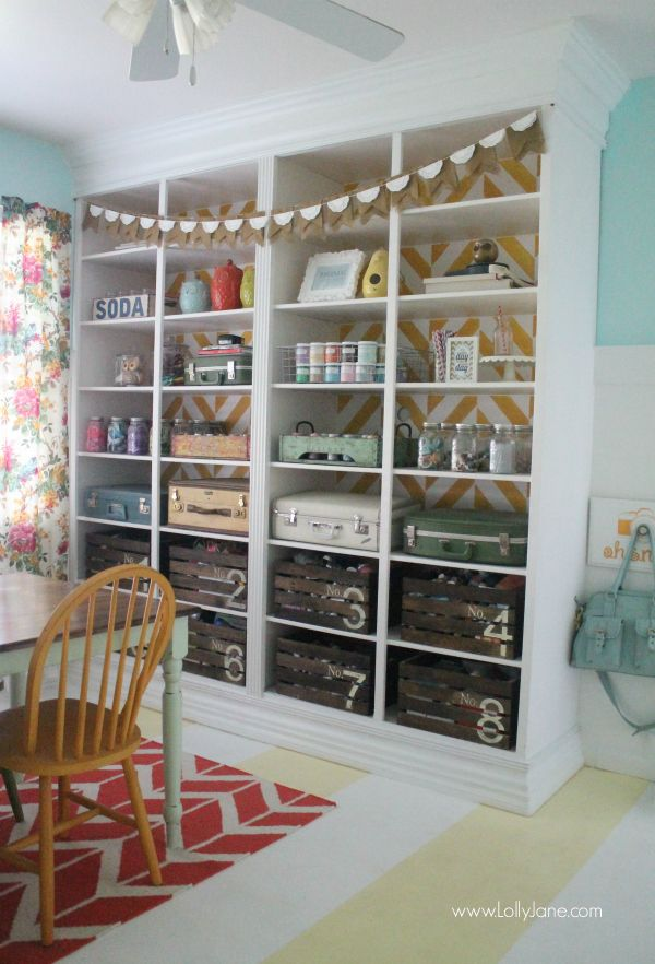 Pretty craft room with a fun herringbone bookcase, striped painted floors and lots of color! @Lolly Jane {lollyjane.com}