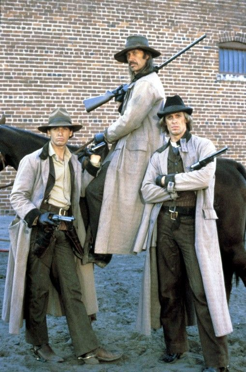 THE LONG RIDERS (1980) - Robert Carradine as 'Bob Younger' (left) & David Carradine on horseback as 'Cole Younger' - Keith Carradine as 'Jim Younger' (right) - Directed by Walter Hill ('Geronimo: An American Legend' - 'Wild Bill') - United Artists.