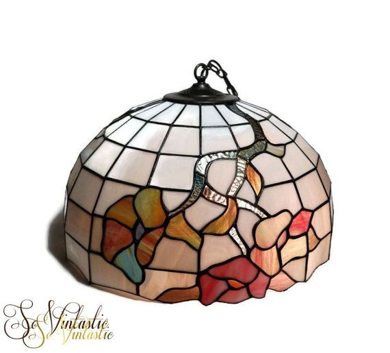 Gorgeous vintage large Tiffany hanging lamp. White and colored 70s stained glass lamp shade, wired and equipped with a cast iron chain link pendant. Tiffany lamp with flower motif. The large lamp shade leaves room for 3 light bulbs. In working, undamaged and clean condition. On offer by SoVintastic on Etsy;-)