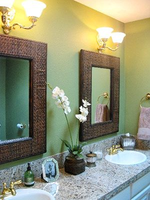 Bathroom - double sinks are so important - and I love the green wall. The brown framed mirrors go perfectly. Plenty of counter space as well.