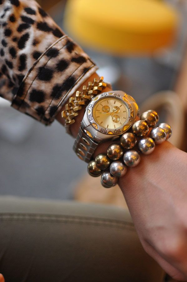 I love to layer multiple bracelets with a watch... this is so me.