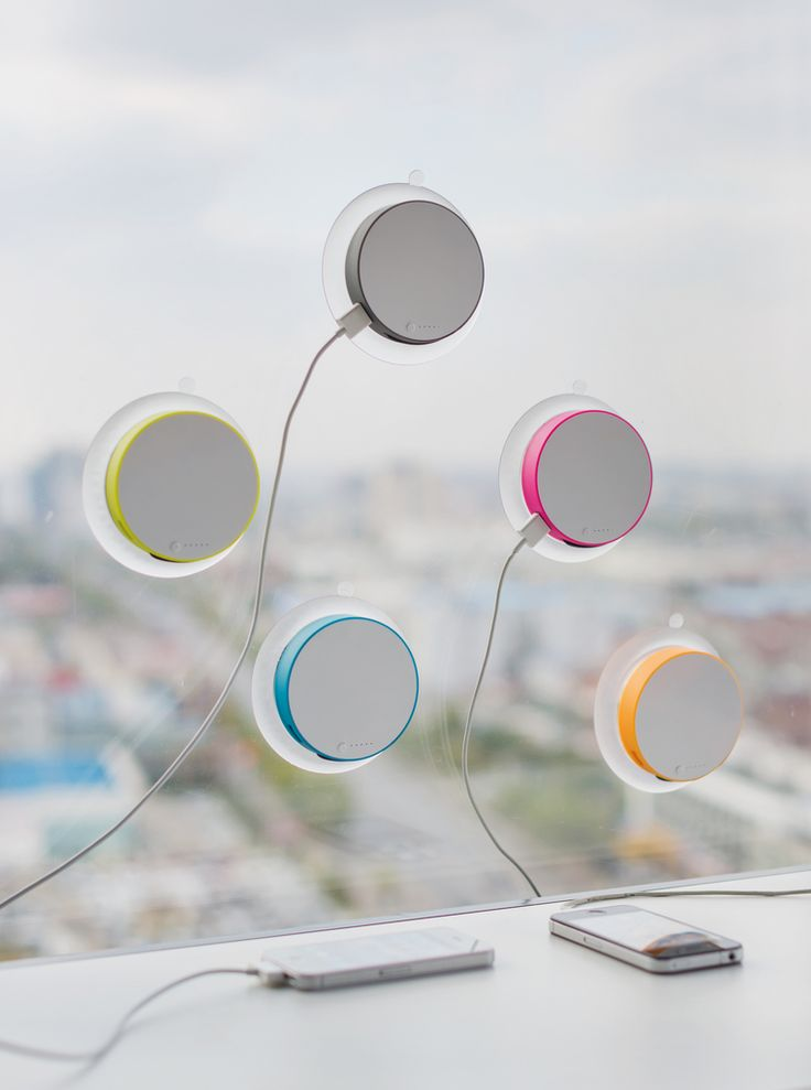 The XD Design Port Solar Charger clings to your window and converts sunlight into useful electricity - and it comes in 4 fun colors!