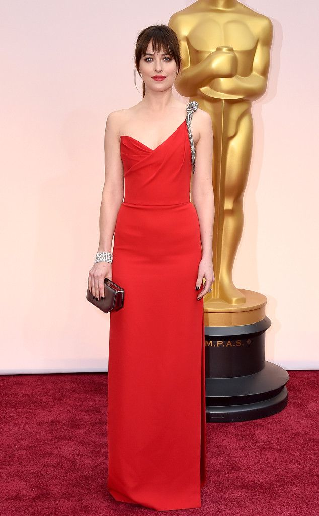 DAKOTA JOHNSON Forget the red room, let's talk about this red dress! The 50 Shades of Grey star brought it in a sexy Saint Laurent dress.