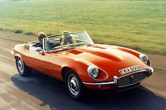 red jaguar e type on a summer day, my favorite car! 12 cylinder of course