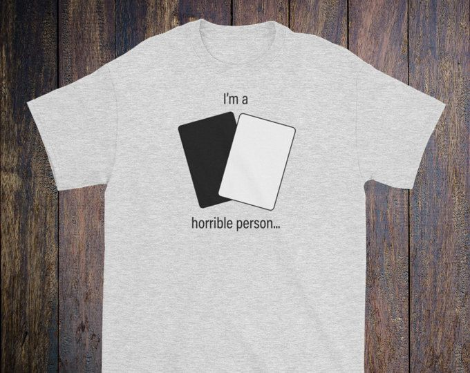 I'm a horrible person T-shirt  The design: Design reads I'm a horrible person... and has one black and one white card. Inspired by the popular Cards Against humanity game.