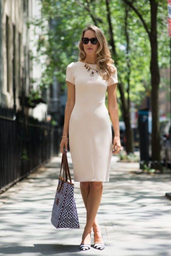 creamy pencil dress, tanned skin, pointy pumps, black shades, raspberry lips, chestlength caramel spirals