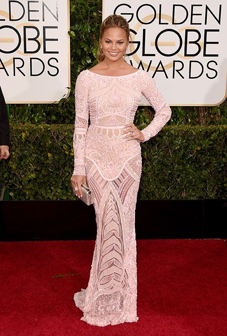 Chrissy Teigen was a knockout at the Golden Globes in her Zuhair Murad dress and bridal ponytail | Brides.com