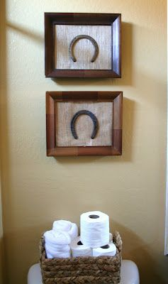 Framed horse shoes - perhaps ones from all those extra special horses... but flip them around so the luck doesn't run out
