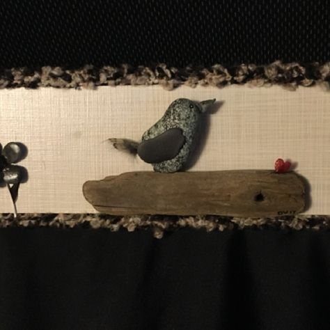 Stone ,drift wood , feathers and dried flowers.