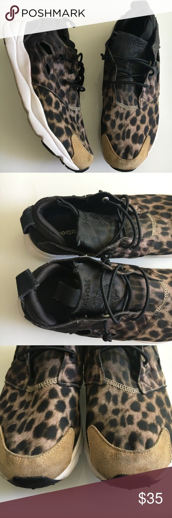 Reebok Leopard Furylite Recognized by its silhouette and unmistakable shape, the shoe is emphasized by an even more daring print: a gradient leopard pattern across the lightweight mesh and neoprene upper. A patch of tan suede can be found at the toe, while a Furylite midsole completes the look.  Brand: Reebok Size: 8 Condition: Used, but very good. Some signs of wear (see photos) Reebok Shoes Sneakers