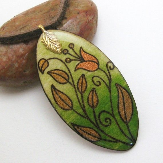 ****SALE ITEM! Original price $25**** This pendant is made with wood that has been etched with a wood burner and hand painted. It is then coated with polymer resin for a high-gloss, protective seal. This pattern will not fade or rub off in any way, as it is burnt into the wood. It comes on a 16 brown suede cord with lobster clasp. I can adjust the length with a chain extension upon request. Please see ruler photograph for pendant dimensions. View other SALE ITEMS here: http:/&#...