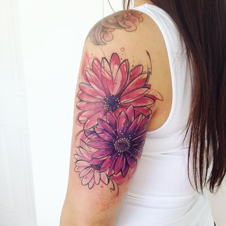 Flower watercolor tattoo. Adrian Bascur is kicking some serious ass when it comes to watercolor tattoos. His watercolor tattoos are something completely out of this world. Enjoy!
