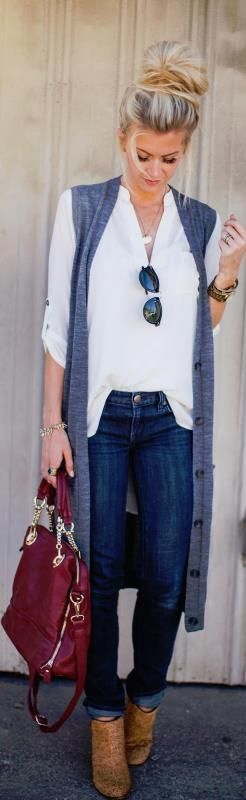 White blouse, jeans, navy blue cardigan sleeveless