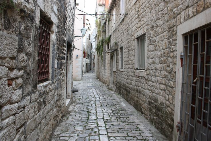 The narrow streets of the historic old town of Trogir in Croatia.