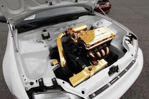 Good looking Honda Civic engine bay with a wire tuck, and gold plated engine.  Very clean.