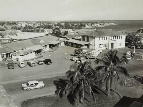 Ward one of the old Darwin Hospital with the administration block of the hospital (left) and the army barracks in the background. c1960s
