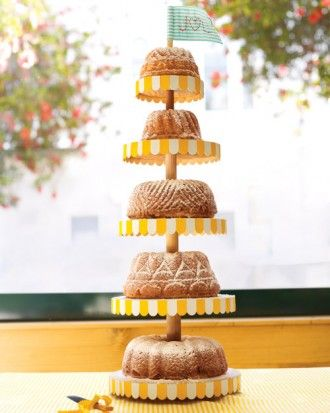 """Boozy Bundt Cakes: An assortment of """"Ridiculous Rum Cakes"""" rested on a stacked cake stand made by the couple. The cakes were baked in antique pans the duo found at flea markets.  [via Jamali Floral and Garden Supplies]"""