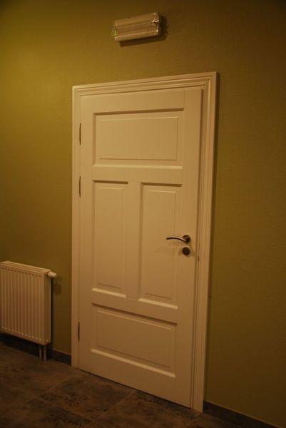 Drzwi Ronkowski- model Piano z opaską profilowaną.