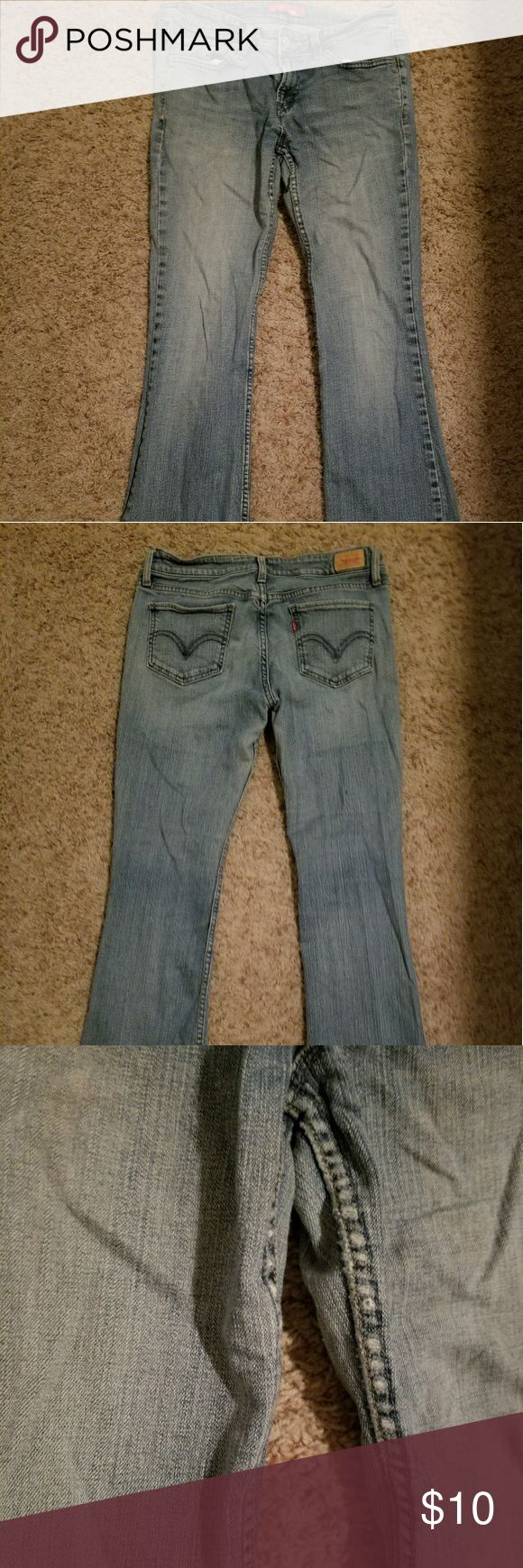 Superlow Bootcut Levi Jeans These have some wear and tear as shown in the 3rd picture it mainly just looks like a small bit of discoloration but price reflects the wear. Size 9/medium. Levi's Jeans Boot Cut