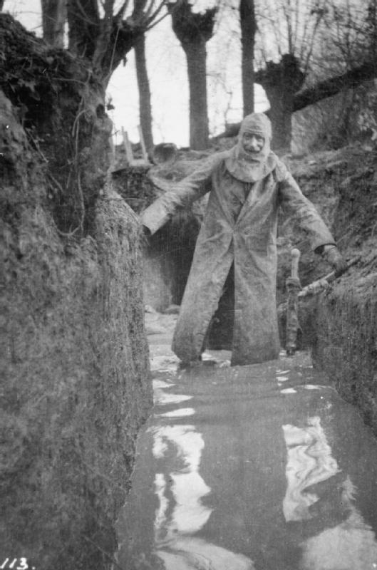 Colonel Philip R Robertson, commanding officer of the 1st Battalion, Cameronians (Scottish Rifles) returning from a tour of his unit's positions in waterlogged trenches at Bois Grenier in January 1915.