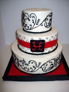 2 tiered simple red white black butter cream wedding cake | Apparently Black & Red are really popular wedding colors!