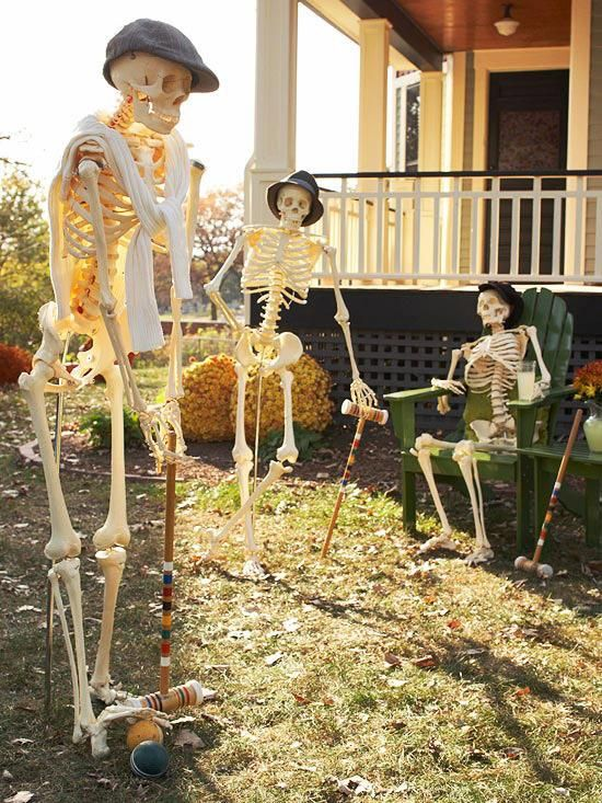 outdoor halloween decorating with skeletons from better homes and gardens like these skeletons playing croquet or make them old with walking canes