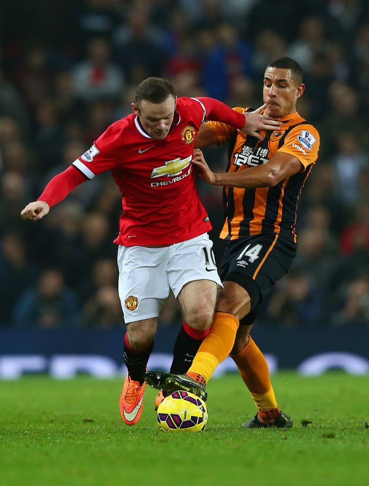 Wayne Rooney of Manchester United and Jake Livermore of Hull City fight for the ball during the Barclays Premier League match between Manchester United and Hull City at Old Trafford on November 29, 2014 in Manchester, England.