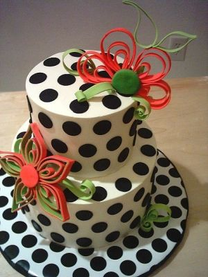 a lovely poke a dot cake with beautiful flowers