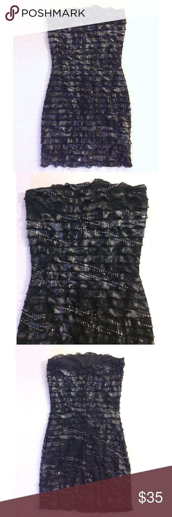 Frilly Metallic Body Con Dress Black and silver metallic Body con dress with layered frills. Ruby Rox Dresses Strapless