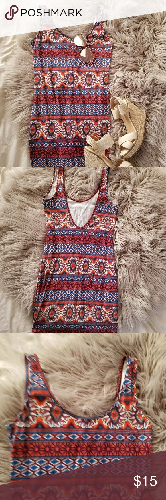 Orange and blue Aztec bodycon dress Orange and blue Aztec print, super flattering body con style dress with deep scoop back , colors make you look so tan, must have for spring break!! I cut out the tag cause it kept showing in the scoop back, but it's from forever 21 , and a size small..  From very top shoulders to very bottom it measures 32 inches. From pit to bottom 25 inches. Forever 21 Dresses