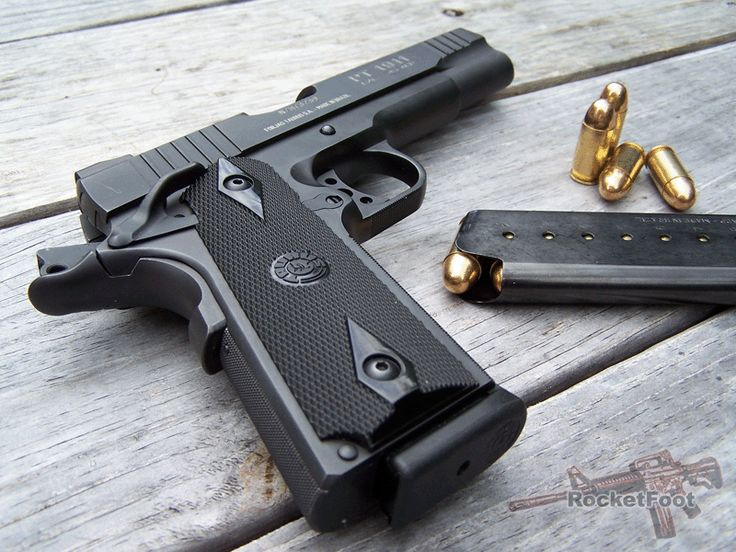 Taurus 1911 .45. My hubby's gun, but with wood grips. Will be mine as soon as I get him the Springfield 1911 he wants. ;-)