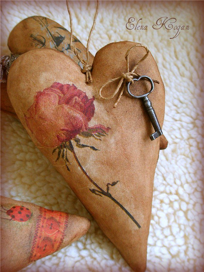 Cloth hearts, stained with coffee/cinnamon/cocoa mixture, decoupaged design