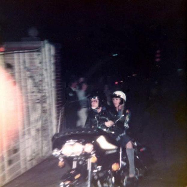 elvis and linda thompson | Linda Thompson riding on the back of Elvis' motorcycle.
