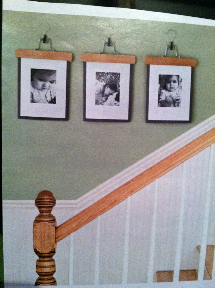 what a unique way to hang pictures or prints a wooden
